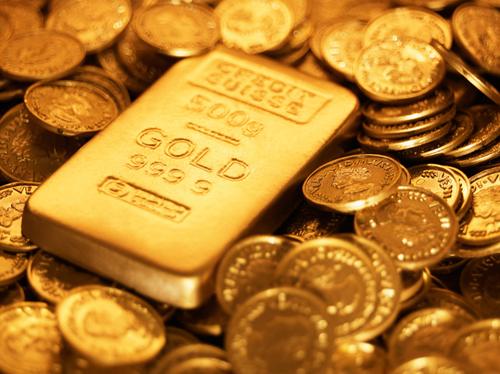 الذهب يرتفع مع تراجع الدولار والأسهم الأمريكية