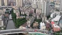 صينية ترفض بيع منزلها وتجبر الحكومة على بناء جسر للالتفاف عليه (صور)
