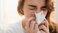 الصداع وسيلان الأنف من أعراض السلالة الجديدة المتحورة من كورونا